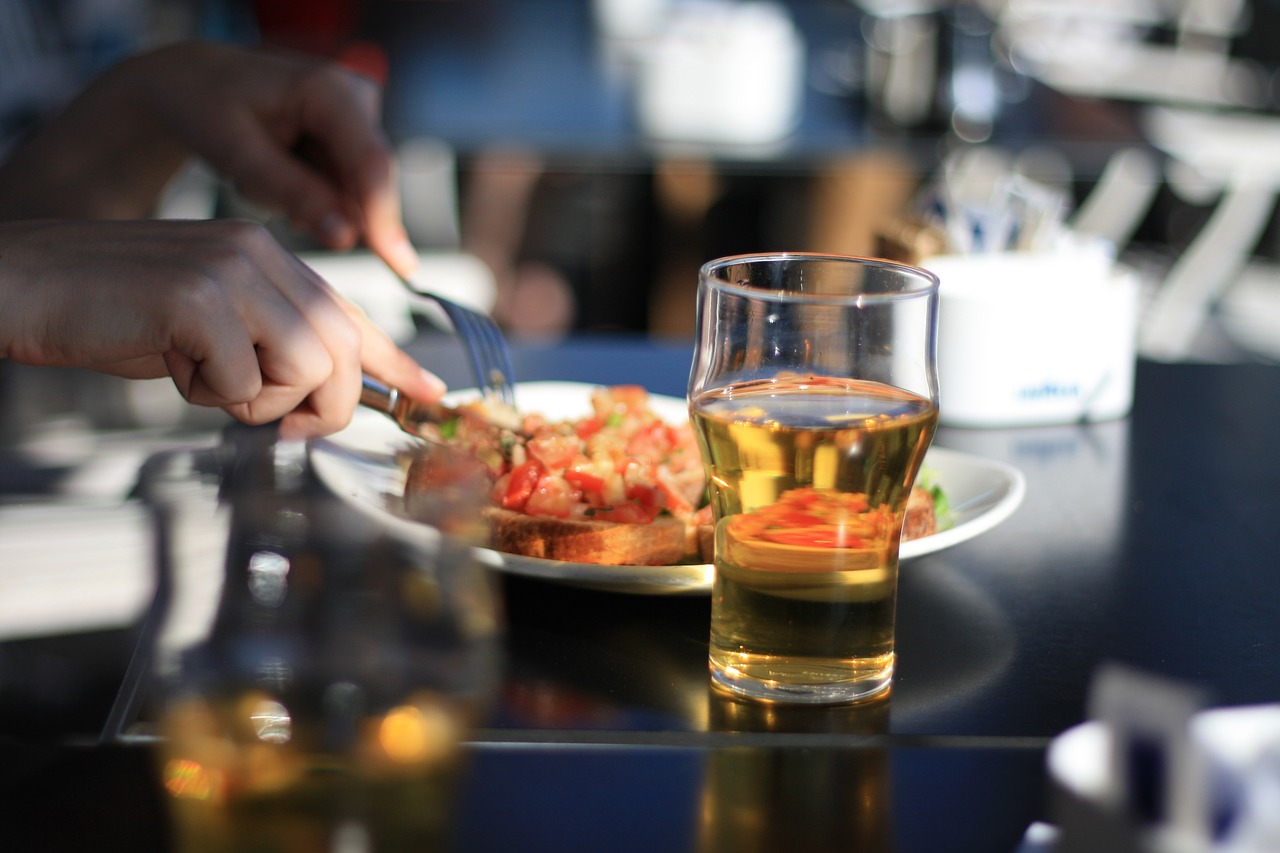 person dining beer and food